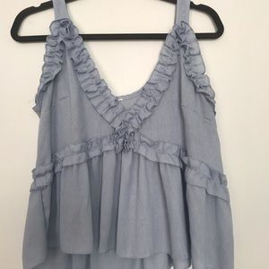Light blue flowy top with ruffled detail- M/L